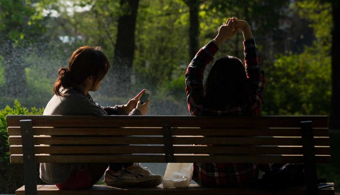 bench people smartphone sun